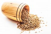 pic of cumin  - spice cumin in a wooden bowl on a white background - JPG