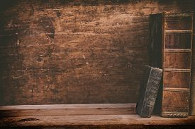 stock photo of librarian  - grunge books on wooden shelf with space for your background - JPG