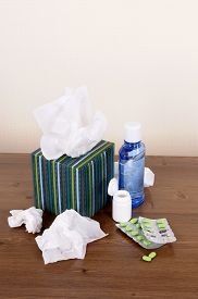 foto of tissue box  - Box of tissues and medicine on a wood table - JPG