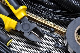 stock photo of wire cutter  - Cutters with electrical component kit for wiring installation - JPG