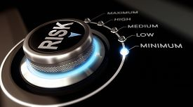 image of risk  - Switch button positioned on the word minimum black background and blue light - JPG