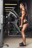 foto of fitness-girl  - beautiful sports fitness girl  in the gym - JPG
