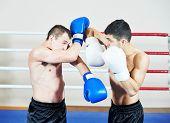 foto of muay thai  - combat sport muai thai sportsman fighting at training boxing ring - JPG