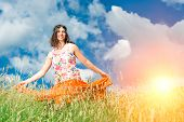 foto of hippy  - Hippie girl in a spring meadow strong colors - JPG