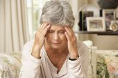 image of retired  - Unhappy Retired Senior Woman Sitting On Sofa At Home - JPG
