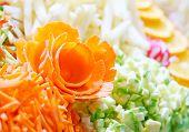 foto of rosettes  - rosette of carrots among the chopped vegetables - JPG