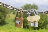 stock photo of three dimensional shape  - Three locks on a thick galvanized chain - JPG