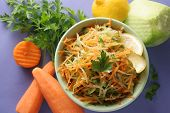 stock photo of grated radish  - salad with carrots black radish and parsley - JPG