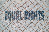 foto of human rights  - Conceptual image with text Human Rights written under wire fence - JPG