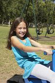 pic of seesaw  - Young Girl Having Fun On Seesaw - JPG
