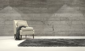 picture of in front  - Minimalist monochromatic living room interior with grey decor and a single armchair standing on a rug in front of a cement brick wall with copyspace - JPG