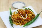 pic of biryani  - Famous Indian dish chicken biryani made with spices and rice - JPG