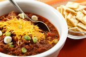 Hearty Chili With Cheese And Scallions