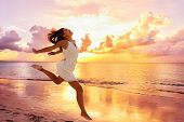 Freedom wellness well-being happiness concept. Happy carefree Asian woman feeling blissful jumping o poster