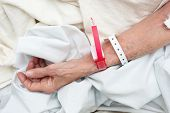 Elderly Woman Wearing Medical Arm Bands