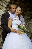 foto of wedding couple  - wedding couple in romantic grotto - JPG