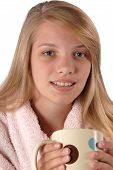 stock photo of housecoat  - Teenage girl wearing a housecoat holding her hot chocolate in studio isolated on white background - JPG