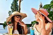 Travel Concepts. Beautiful Girl Is Eating At A Seaside Restaurant. Asian Girls Come To Relax At The  poster