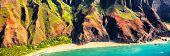 Hawaii Na Pali coast travel vacation aerial of Honopu beach on Kauai island, Hawaii, USA. Background poster