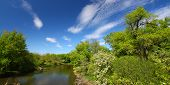 foto of winnebago  - Beautiful blue skies on a spring day along the Kishwaukee River of Illinois - JPG