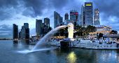 SINGAPORE-DEC 29: The Merlion fountain and Singapore skyline on Dec. 29, 2010. Merlion is an imagina