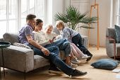 Happy Family With Children Using Mobile Apps Together At Home, Young Couple And Kids Having Fun Play poster