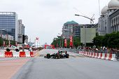 PUTRAJAYA, MALAYSIA - APRIL 2: Team Lotus test driver drives around the streets of Putrajaya at the