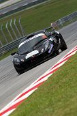 SEPANG - JUNE 17: Ravindra Panchalingam in a Lotus Exige S takes to the tracks of the Sepang Interna