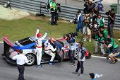 SEPANG - JUNE 19: Weider Honda Racing team drivers Takashi Kogure and Loic Duval celebrate their win