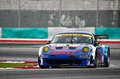 SEPANG, MALAYSIA - JUNE 19: Samurai Team Tsuchiya's Porsche 911 car takes turn 1 of the Sepang Circu