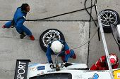 SEPANG - JUNE 19: LMP Motorsport pit crew prepares to refuel and change tires during a pit-stop of t