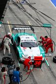 SEPANG - JUNE 19: Lexus Team Petronas Tom's pit crew prepares to refuel and change tires during a pi
