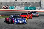 SEPANG - JUNE 19: The race car of Lexus Team Zent Cerumo moves into turn 2 closed followed by others