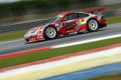 SEPANG, MALAYSIA - JUNE 18: The Porsche car of Team Taisan Cinecitta speeds on the straights of the