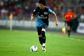 BUKIT JALIL, MALAYSIA - JULY 13: Arsenal's Japanese player Miyaichi makes a play against Malaysia on July 13, 2011 in Stadium Bukit Jalil, Malaysia. English league team Arsenal is on an Asia Tour.