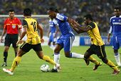BUKIT JALIL, MALAYSIA - JULY 21: Chelsea's Didier Drogba (blue) dribbles the ball past Malaysian pla