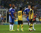 BUKIT JALIL, MALAYSIA - JULY 21: Chelsea's Nicolas Anelka (left, in blue) waits for a free kick in a game against Malaysia at the National Stadium on July 21, 2011 in Bukit Jalil, Malaysia. Chelsea won 1-0.