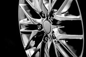 Luxury Chrome Alloy Wheel In Close-up As An Automotive Background (b&w Hdr Filter). poster
