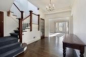 Foyer in traditional home with brown and white staircase