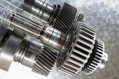aerospace gear wheels set against brushed aluminum, blue toning concept