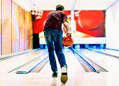 Постер, плакат: Boy about to roll a bowling ball hobby and leisure concept
