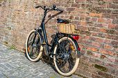 Black Retro Vintage Bicycle With Old Brick Wall. poster