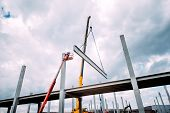 Crane Lifting  Concrete Frameworks, Shutterings And Heavy Prefabricated Concrete Components At Const poster