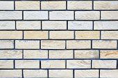 Brick Wall Of Light Beige And Yellow Brick. Smooth A Few Rows Of Bricks. Laying Overlap. The Surface poster