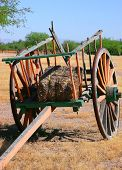 stock photo of hayride  - An old wooden wagon with hay and large wooden wheels - JPG