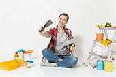 Woman In Casual Clothes Sitting On Floor With Putty Knife, Instruments For Renovation Apartment Room poster