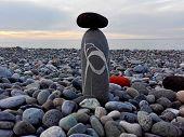 Stones Pyramid Or Tower On Pebble Beach Symbol Stability Zen Harmony Balance. Pebble Stone Black Tow poster