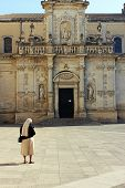 foto of nouns  - nun in front of the church  on a sunny day - JPG
