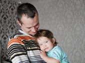 Loving Father Hugs The Child In His Arms. Baby 0-1 Year Old. Fatherly Love. The Relationship Of Fath poster