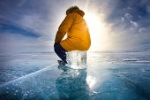 Traveller Man Raise Up Hand Freedom And Enjoy View Of Beautiful Landscape Natural Breaking Ice In Fr poster